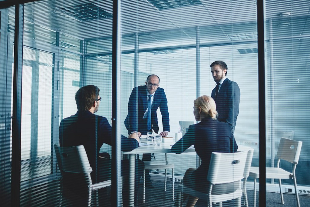 Business team having meeting by workplace